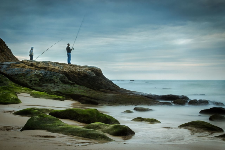 Two guys fishing in a cloudy day